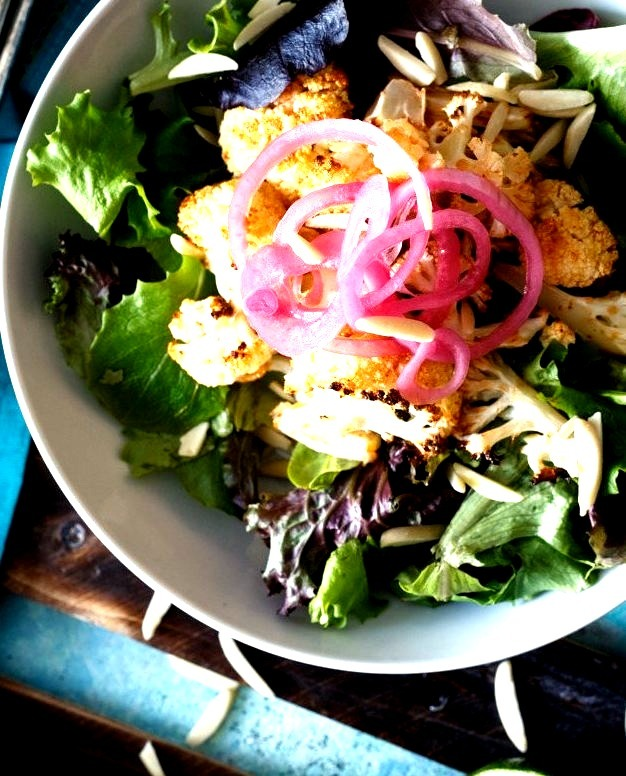 Honey Sriracha Cauliflower Salad with Pickled Onions and Avocado Yogurt Dressing
